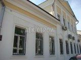 Шпаклёвка - Шпаклёвка по сетке базовым слоем фасада административного здания
