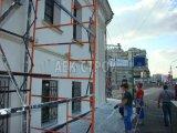Шпаклевка фасада здания по сетке базовым слоем