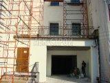 Ошпаклёваный финишным слоем фасад здания